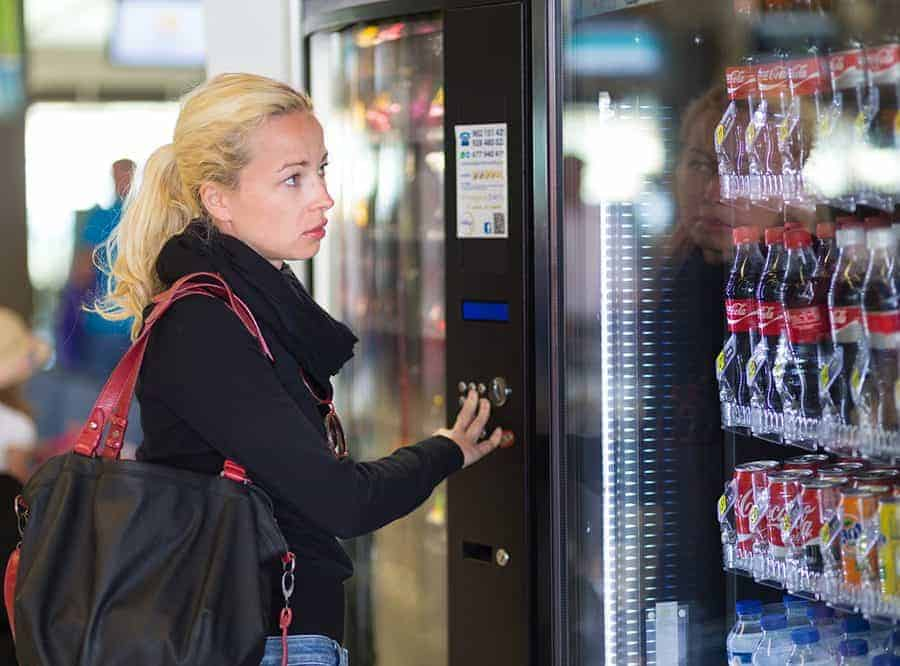 Lady using vending machine