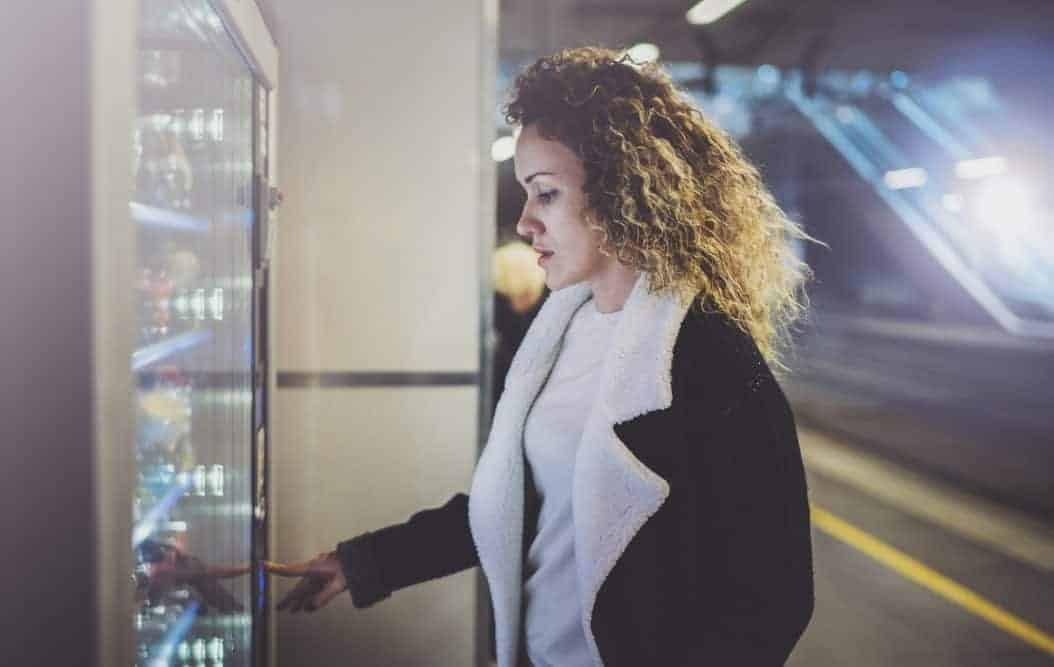 Woman buying vending machine
